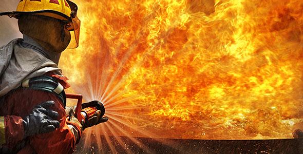 تصویر پس زمینه آتش نشان و مهار آتش بزرگ