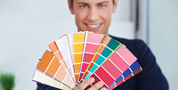 happy-graphic-designer-holding-color-fan