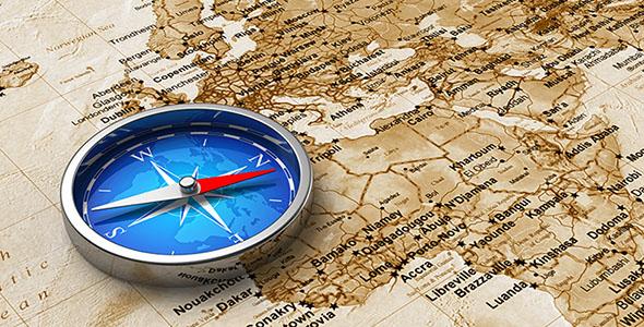 تصویر نقشه قدیمی و قطب نمای فلزی