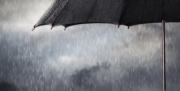 تصویر دست انسان و نگه داشتن چتر سیاه