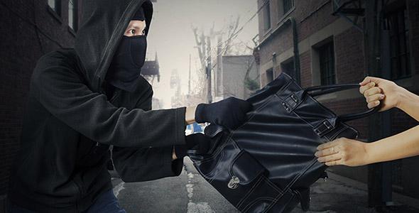 تصویر مرد جوان دزد و کیف قاپ