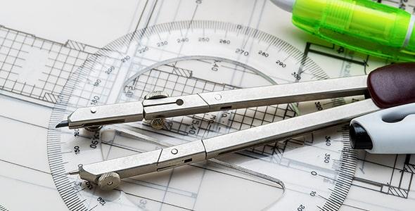 تصویر کلوزآپ پرگار با مفهوم طراحی نقشه