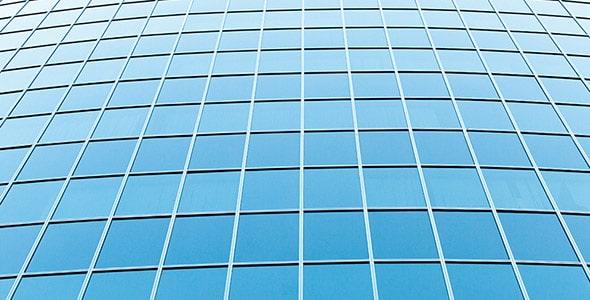 تصویر پس زمینه نمای جلو ساختمان با پنجره
