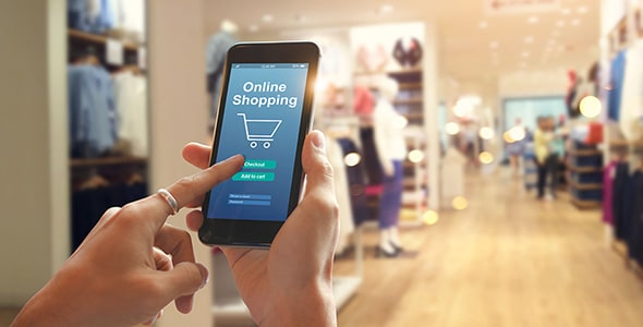 تصویر دست زن با موبایل و مفهوم خرید آنلاین