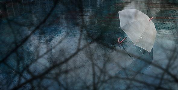 تصویر پس زمینه چتر سفید در روز بارانی